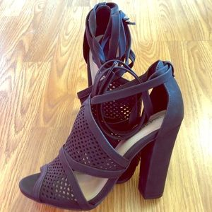 Black bootie heels with cutout